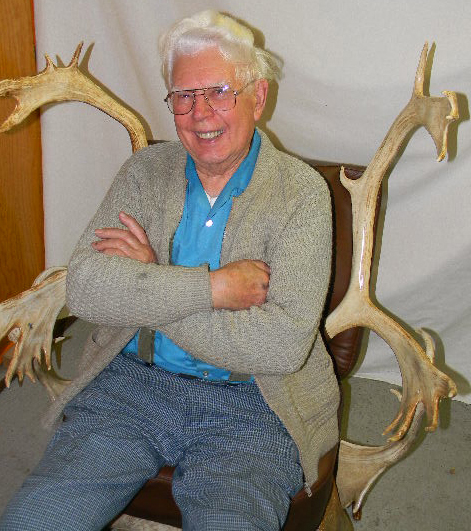 Bill Steckman on antler chair