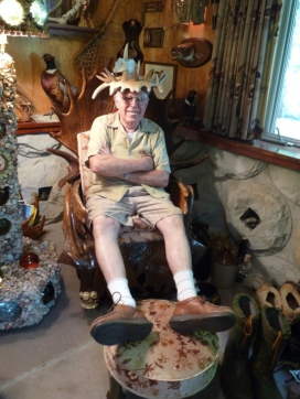 Bill Steckman with antler crown on antler throne