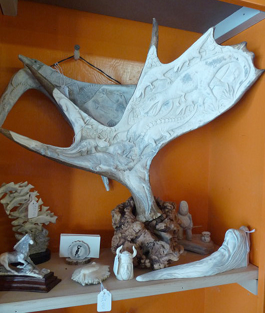 Dinosaurs on moose antler, artist unknown