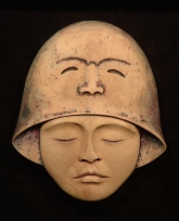 'Bell-Faced Helmet' (carved and and coloured antler) by Maureen Morris