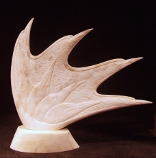 'Eight Birds' (carved caribou antler) by Maureen Morris