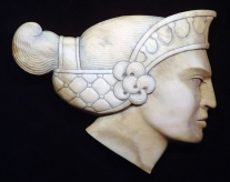 'Greek Woman in Profile' (carved and stained moose antler) by Maureen Morris