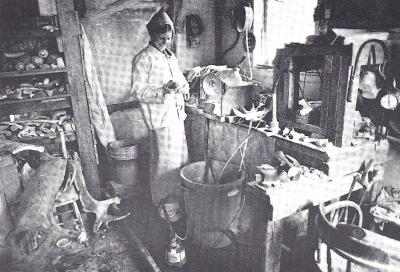Maureen Morris in her studio carving jade and antler.