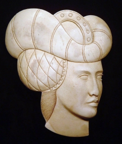'Padded Hat Woman' (carved and stained antler) by Maureen Morris
