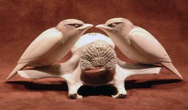 'Two Starlings on a Vertebra' (carved caribou antler and bone) by Maureen Morris