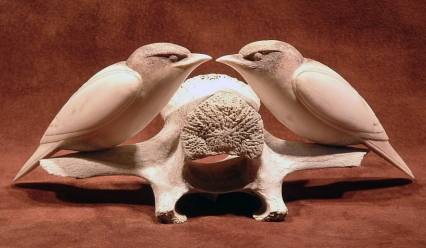 'Two Starlings on a Vertebra' (carved caribou antler and bone) by Maureen Morris