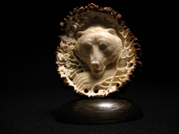 'Bear in Blossoms' by Dmitry Gorodetsky (carved deer antler - 5cm x 8cm)