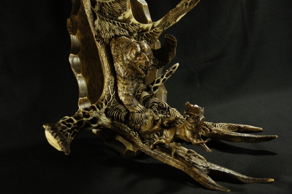 'A Sudden Encounter' by Dmitry Gorodetsky (carved and stained moose antler and wood - 23cm x 45cm)
