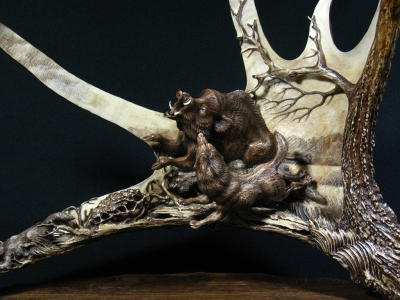 'Wild Boar and Laika - 2' by Dmitry Gorodetsky (carved and stained moose antler and wood - 45cm x 25cm)
