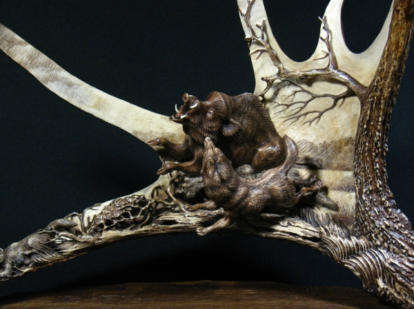7. 'Wild Boar and Laika - 2' by Dmitry Gorodetsky (carved and stained moose antler and wood - 45cm x 25cm)