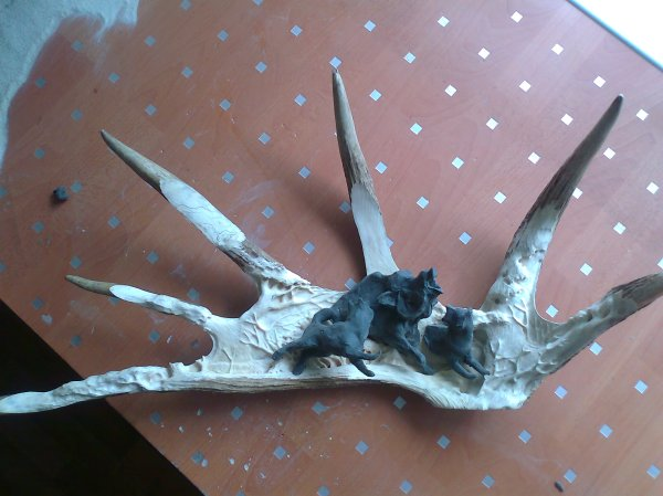 Phase 2 - The figures are modelled in plastercine and fitted to the moose antler background, prior to being carved in wood. (Dmitry Gorodetsky mixed media moose antler sculpture, in progress)