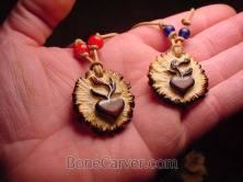 Jack Browns carved 'Love Seeds' necklaces