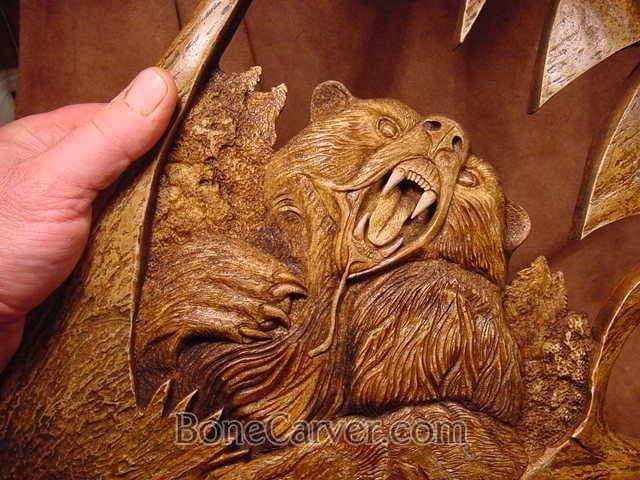 Bear carved into moose antler, by Jack Brown