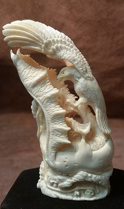 'Battle of the Ages 2' by Jack Brown (carved sperm whale tooth)