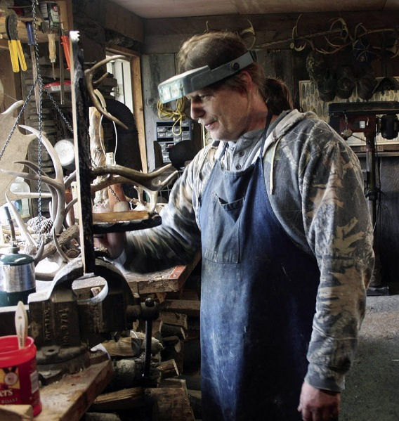 Jack Brown, Bonecarver, in his studio (photo credit Olean Times Herald)