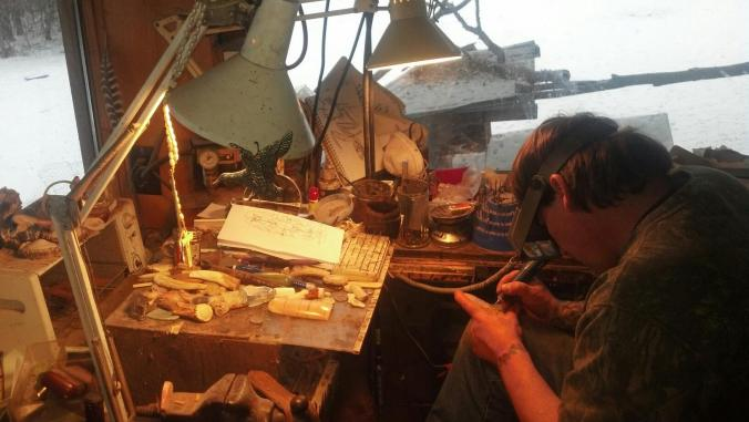 Jack Brown at work in his studio. Dale Baldwin's carving hang on the lamp as a reminder to Jack of his mentor and friend.