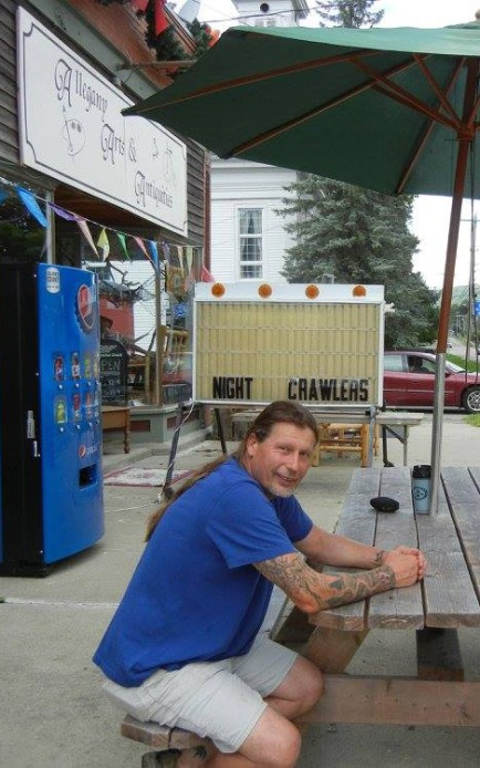 Jack Brown taking a break from carving to get some fresh air out in front of his studio/gallery in Scio, N.Y. USA